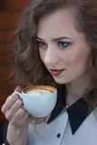 Close up portrait of beautiful girl with coffee Stock Photo