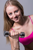 Close-up portrait of a beautiful girl with dumbbell Stock Image