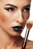 Close up portrait of beautiful girl holdin a make up brush Stock Image