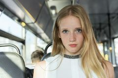 Close up portrait of a beautiful girl in public transport stock photo