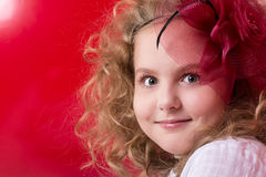 Close-up portrait of a beautiful girl in a red divlennoy hat Royalty Free Stock Photo