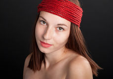 Close-up portrait of beautiful girl with red rope Stock Images