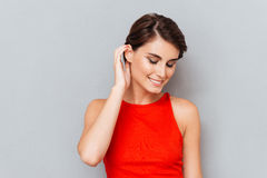 Close up portrait of a beautiful girl in red top Stock Images