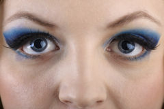 Close-up portrait of beautiful girl's eye-zone make-up with blue Stock Photos