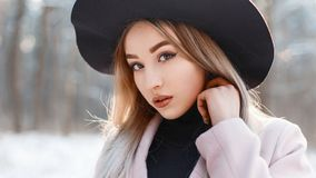 Close-up portrait of a beautiful girl in a stylish hat on a wint. Er day. fashion winter Royalty Free Stock Image
