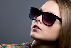 Close-up portrait of beautiful girl in sunglasses Stock Images