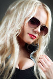 Close-up portrait of beautiful girl in sunglasses Stock Photography