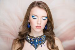 Woman blue necklace bright make up stock images