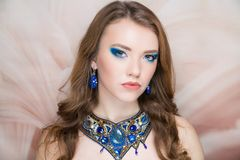 Woman blue necklace bright make up stock photo