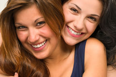 Close up portrait of beautiful girls hugging Royalty Free Stock Photos
