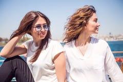 Close up portrait beautiful girls on yacht have fun stock image