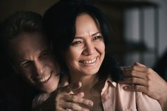 close-up portrait of beautiful happy multiethnic couple looking away while man royalty free stock image