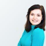 Beautiful brunette girl smiling cheerfully Stock Image