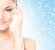 Close-up portrait of a beautiful and healthy woman on the snow Stock Photo