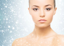 Close-up portrait of a beautiful and healthy woman on the snow Royalty Free Stock Image