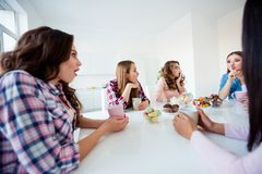 Close up portrait beautiful she her ask silence ladies group buddies sit round big white table bright kitchen hold cups. Close up portrait beautiful her ask royalty free stock image