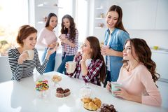 Close up portrait beautiful she her ladies missed family meeting sister cousins stand sit round big white table bright. Kitchen hold cups share novelty stock photo