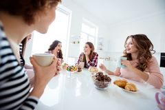 Close up portrait beautiful she her wondered delighted ladies group buddies sit round big white table bright kitchen. Close up portrait beautiful her wondered royalty free stock photos