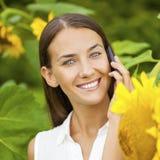 Close-up portrait of beautiful joyful woman with sunflower Royalty Free Stock Photography