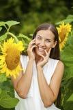Close-up portrait of beautiful joyful woman with sunflower Stock Image