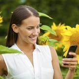 Close-up portrait of beautiful joyful woman with sunflower Royalty Free Stock Image