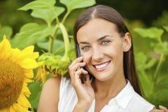 Close-up portrait of beautiful joyful woman with sunflower Stock Images