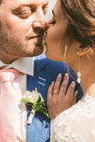 Close up portrait of beautiful kissing married couple Royalty Free Stock Photo
