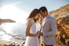 Close up portrait of a beautiful married couple. At the beach Stock Photos
