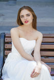Close up portrait of beautiful model woman in long white dress Stock Images