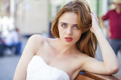 Close up portrait of beautiful model woman in long white dress Stock Photography