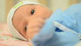 Close-up Portrait of a Beautiful Newborn Baby, First Activity stock video footage