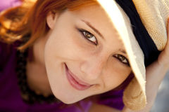 Close-up portrait of beautiful red-haired girl. Royalty Free Stock Photo