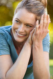 Close-up portrait of beautiful relaxed woman at park Royalty Free Stock Image