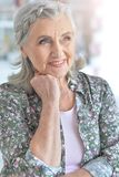 Close up portrait of beautiful senior woman. Close up portrait of smilling beautiful senior woman posing at home royalty free stock image