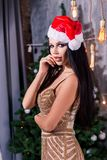 Close up portrait of beautiful girl wearing santa claus clothes. Christmas woman stock images