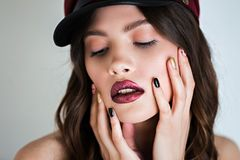 Close up portrait of beautiful sexy stylish brunette young woman model with bright makeup with shiny Burgundy lips. Closeup portrait of beautiful sexy stylish Stock Photo
