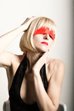Close up portrait of beautiful sexy young blonde woman  with a bandage on his eyes, puts her hand to her hair Royalty Free Stock Image