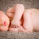 Close-up portrait of a beautiful sleeping baby on blanchet Stock Photo