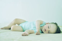 Close-up portrait of a beautiful sleeping baby. Cute infant kid. Child portrait in pastel tones. Stock Photo