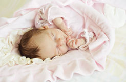 Close-up portrait of a beautiful sleeping baby. Stock Photo