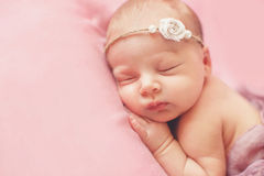 Close-up portrait of a beautiful sleeping baby. royalty free stock images