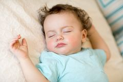 Close-up portrait of a beautiful sleeping baby on white royalty free stock image