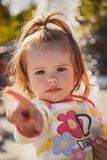 Close up portrait of beautiful small baby, blond little girl in Stock Photos