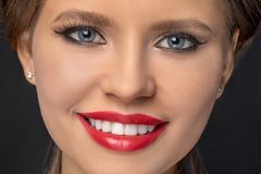Close-up portrait of a beautiful smiling girl royalty free stock photo