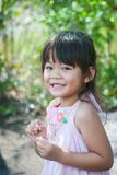 Close up portrait of a beautiful smiling little girl. In pink dress Royalty Free Stock Image