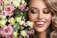 Close up portrait of beautiful woman. Flowers near her face stock photo