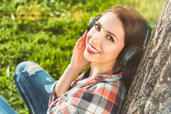 Close-up portrait of beautiful smiling woman with headphones Stock Photography