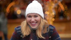 Close-up Portrait of a Beautiful Smiling Young Woman Wearing Warm Clothing. Girl Laughing and Looking at the Camera stock video