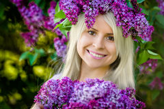 Close up portrait beautiful smiling young woman is wearing wreat Royalty Free Stock Photos