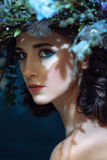 Close-up Portrait of a beautiful spring girl with wreath on head Stock Photo